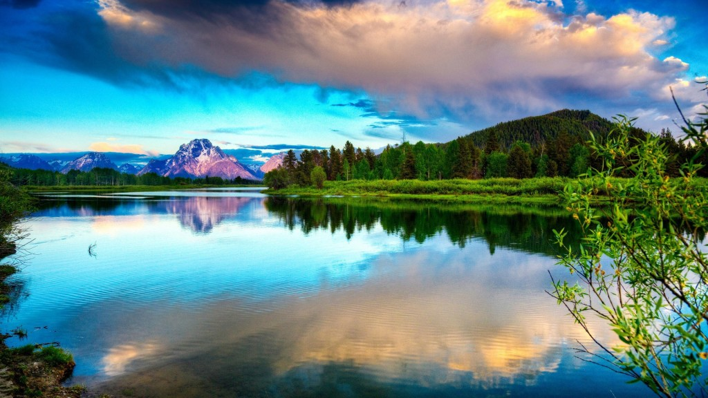 lake_mountains_clouds_smooth_surface_reflection_sky_brightly_branches_62326_1920x1080