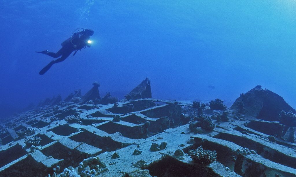 Scuba diver exploring the Giannis D shipwreck, Egypt, Red Sea