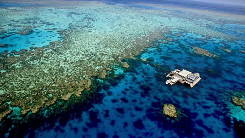simon o dwyer. gen news. 20050210. pic shows. The Agincourt number three reef from the Quicksilver Eight pontoon on the Great Barrier Reef. A team of researchers have placed a shade cloth 5m x 5m on the surface of the ocean to protect the coral from the sun which is causing bleaching on the reef. SPECIALX REEF
